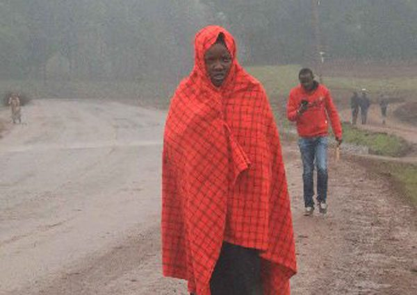 A resident of Wamagana village in Tetu shield herself from cold on June 28, 2016. According to Aberdare Region Director of Meteorology Francis Nguatah, the weather temperatures are likely to go below 10 degrees Celsius in July all the way to August. PHOTO | JOSEPH KANYI | NATION MEDIA GROUP