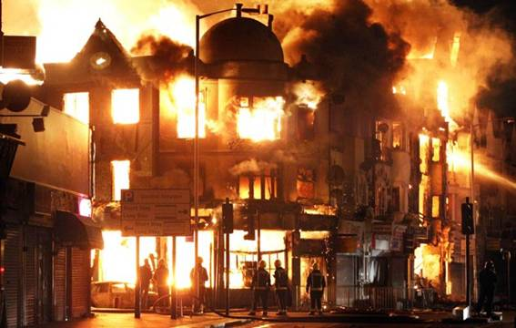 A property is on fire near Reeves Corner in Croydon, south London, Tuesday, Aug. 9, 2011. A wave of violence and looting raged across London and spread to three other major British cities on Tuesday,