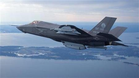 Description: The U.S. Marine Corps version of Lockheed Martin's F35 Joint Strike Fighter, F-35B test aircraft BF-2 flies with external weapons for the first time over the Atlantic test range at Patuxent River Naval Air Systems Command in Maryland in a February 22, 2012 file photo. REUTERS/Lockheed Martin/Handout