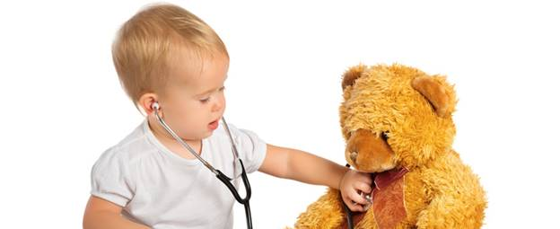baby using stethoscope on teddy bear