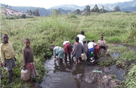 ugandan children fetch contaminated drinking water photo